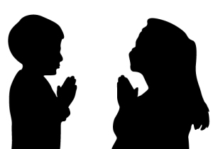 child-praying-silhouette