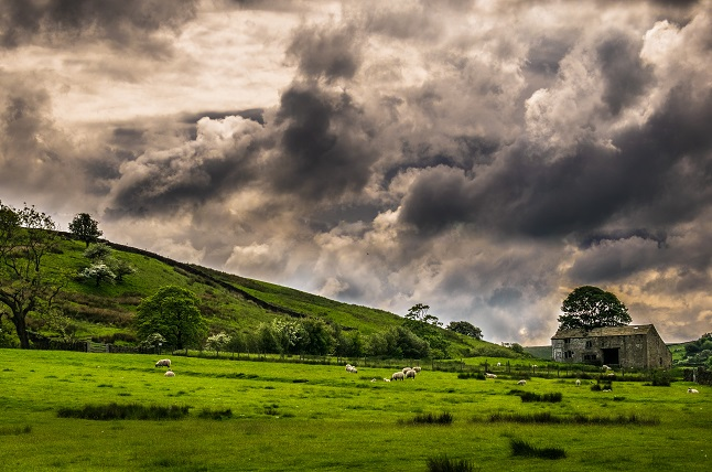Dramatic sky over countryside on springtime in Forest of Bowland, Lancashire, England UK