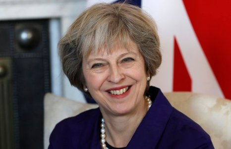 Britain's Prime Minister Theresa May smiles during a bilateral meeting with Colombia's President Juan Manuel Santos at 10 Downing Street in London